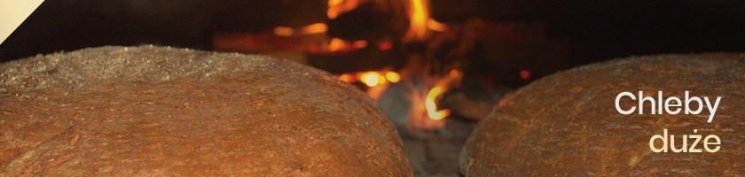 Duże Chleby Wiejskie na Zakwasie Pieczone na Liściu Kapusty